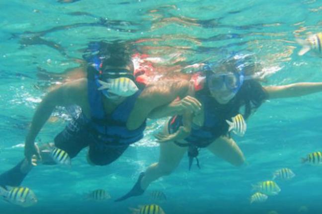 two people snorkeling
