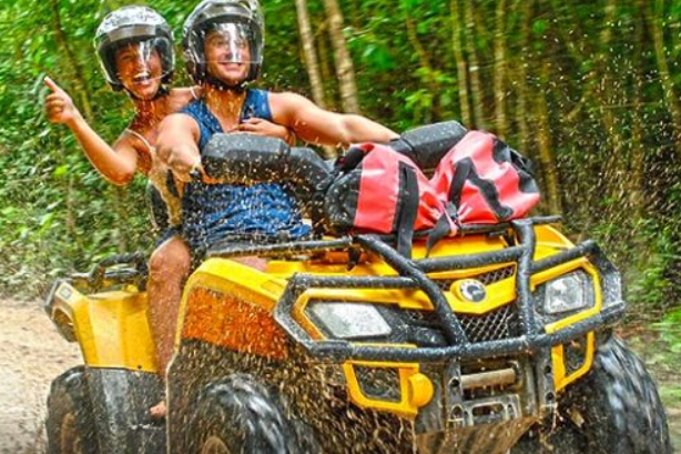 two people on ATV in the jungle